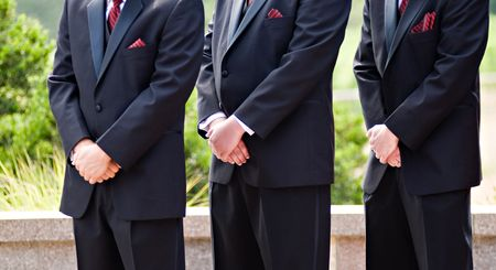 Three groomsmen with hands crossed Stock Photo