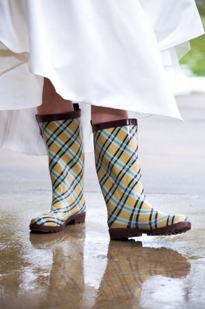 white winter: Close up of rain boot worn by a bride for a winter wedding Stock Photo