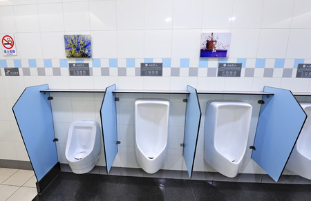 urinal: urinal bowl in the men toilet