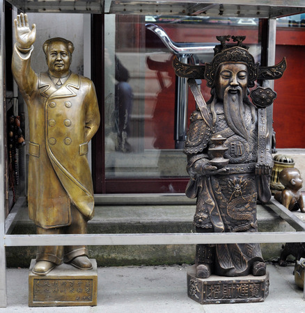 mao: Sculpture of Mao zedong and Chinese god of wealth