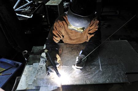 argon: worker welding in the workshop