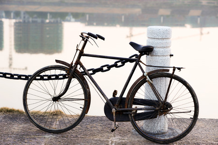 'pull over': old bicycle by the riverside