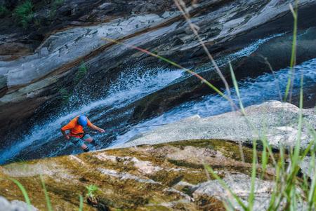 Rock climbing down the waterfall