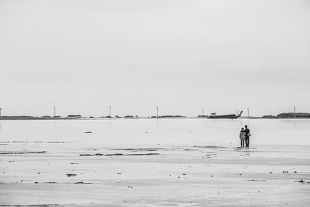 relying: A couple standing at the sea