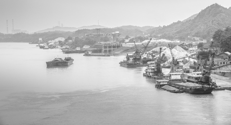 mining ships: Dredging in monochrome effect Editorial