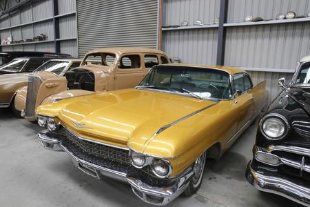 Antique cars in a garage