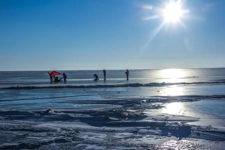 frozen lake: People playing at frozen lake