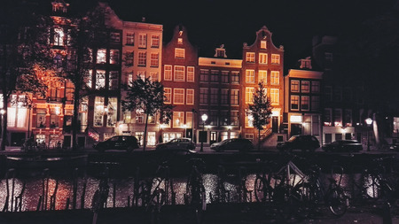dutch canal house: Amsterdam canal houses at night