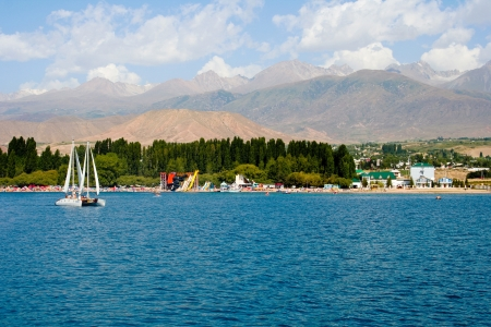 issyk kul: View of the coast of the Issyk-Kul with The sides of the water Editorial