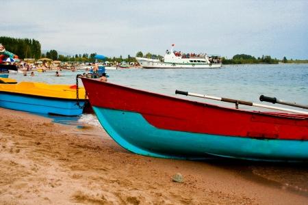 issyk kul: Old boat on the shore of Lake Issyk-Kul