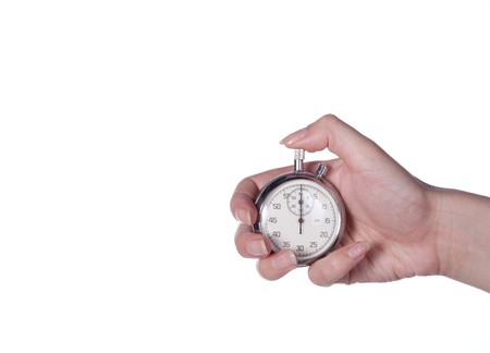 Stopwatch in a female hand on a white photo