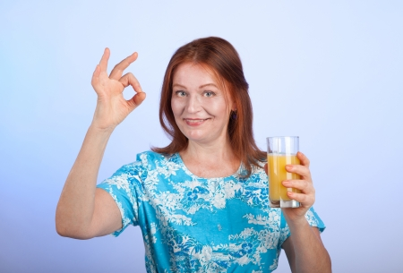 an elderly woman with a glass of orange juice photo
