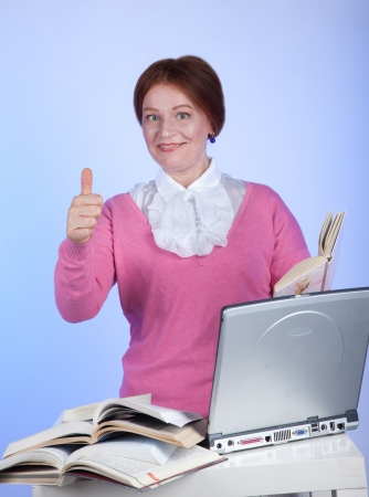 elderly woman learns to work at the computer photo