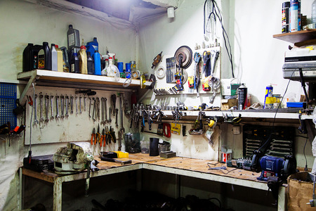 old tools: workbench with old tools in the garage