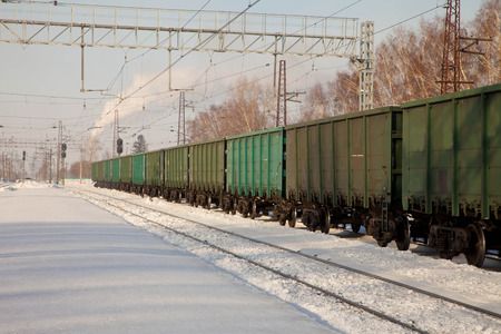 flatcar: freight cars at the station in winter