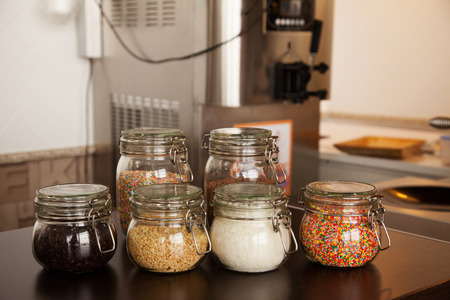 toppings: toppings for ice cream in glass jars Stock Photo