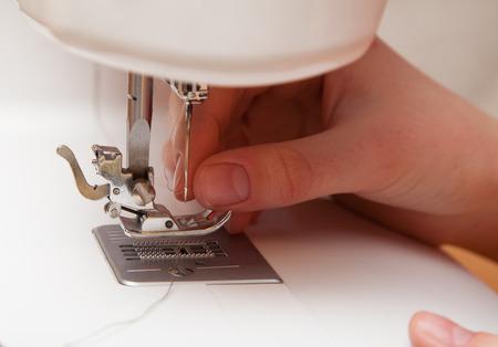 cotton thread: threading a needle thread sewing machine close-up