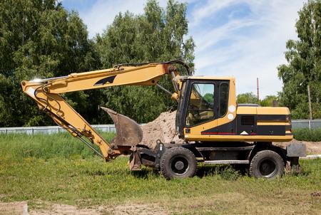 power shovel: excavator; power shovel; dredge standing on the ground