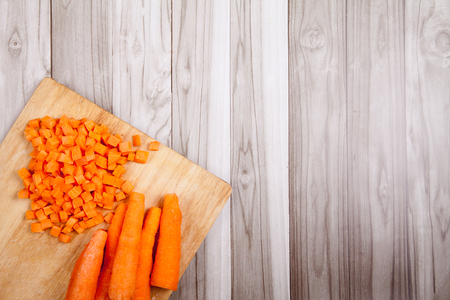 Carrots raw cut on a wooden table Stock Photo