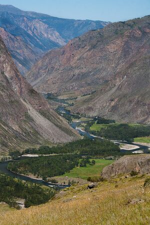 Top view of the winding Chulyshman River in Altai. The Katu Yaryk pass in the summer. Russia . Tourism Travels.