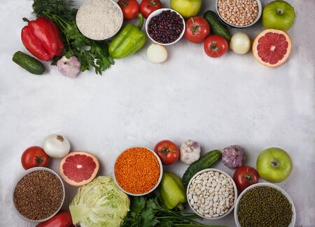 Vegan health food concept for a high fibre diet with fruit, vegetables, cereals, grains, legumes , herbs. Foods high in antioxidants, vitamins. Immune boosting. Flat lay Banco de Imagens