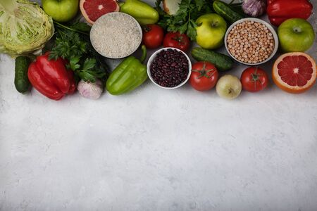 The concept of a healthy vegetarian food, rice products, chickpeas, vegetables and fruits on a light background. Food rich in antioxidants and vitamins. Copy spaes Banco de Imagens
