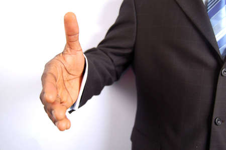 This is an image of a businessman offering a handshake.