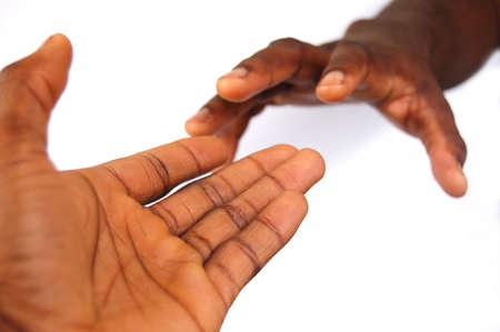This is an image of a pair of black hands reaching out to each other. This can be used to represent love, hope etc...