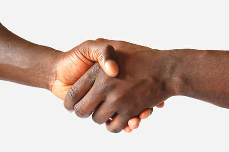 This is an image of two hands performing a left handed, handshake. Stock Photo