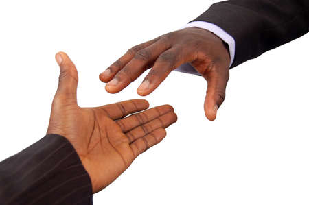 bothered: This is an image of a pair of black business hands reaching out to each other. Metaphor for contract agreement, business help, employment opportunities etc..