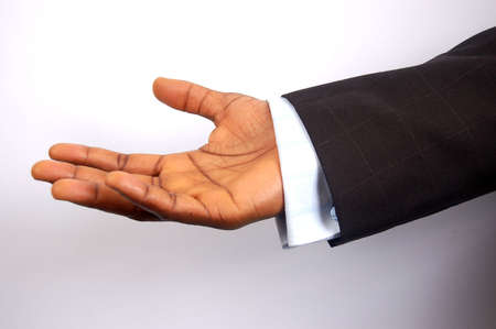 This is an image of a black businessman offering his hand. This is a metaphor for business assurance, business trust etc.