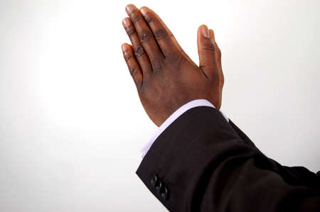 This is an image of businessman with hands in a prayer posture.  photo