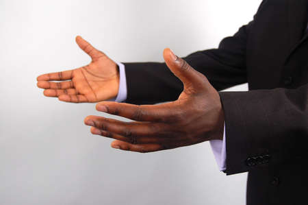 reached: This is an image of a pair of hands offering help, business style.