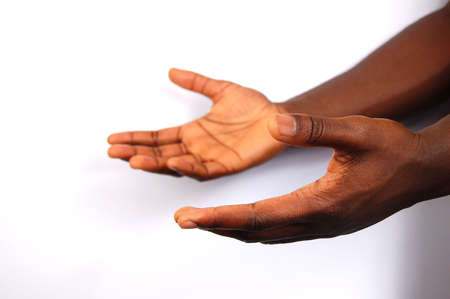 This is an image of a pair of black hands offering help.