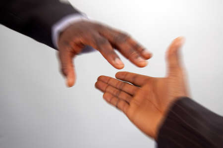 This is an image of a pair of hands reaching out to each other, in speedy motion. Stock Photo