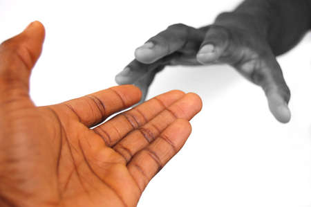 This is an image of a pair of black hands reaching out to each other. One hand is in bw and the other in colour to communicate depth. This can be used to represent love, hope, change etc...