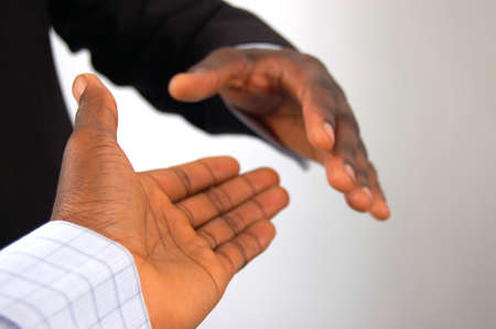 This is an image of a two hands about to perform a handshake.