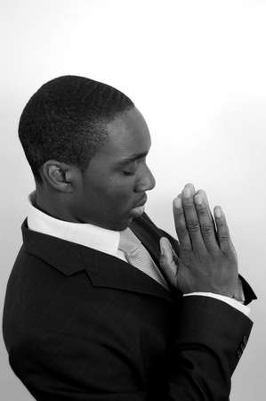 This is an image of a man on his knees praying Stock Photo