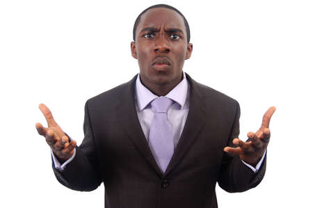 This is an image of a businessman making a statement of anger. This image can be used to represent