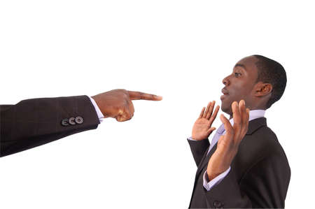 This is an image of a hand pointing at a businessman. This image can used to represent blame themes, accusation etc...