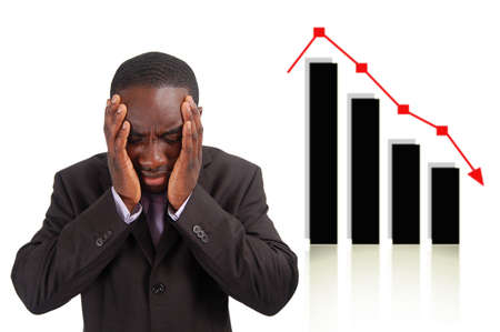This is an image of a man deeply depressed due to a drop in the graph. This image can be used to represent stock losses, sales losses etc.. Stock Photo