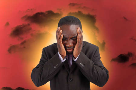 This is an image of a man feeling the heat and pressure, from everyday business. Stock Photo