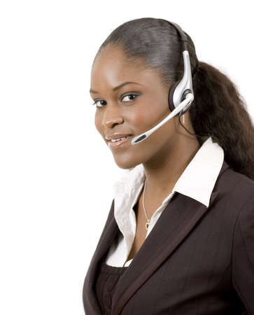 This is a close-up image of a female call operator. This image can be used for telecommunication and service themes. (Editted over white for easy clipping)