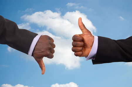 This is an image two hands competing against each other with a sky in the background.This image can be used to represent the theme Business Challenge