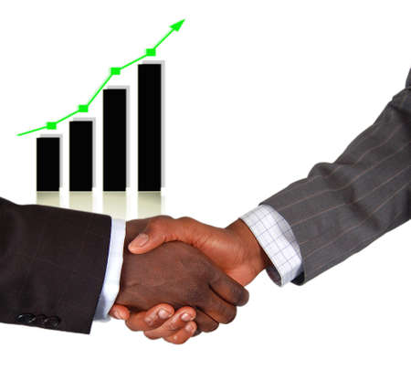 This is an image of two businessmen performing a handshake, celebrating the rise in profits (graph rise). Stock Photo