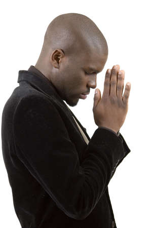 This is an image of a businessman in a state of prayer. This image can be used to represent Peace Maker, Faith , Business Vision etc... Stock Photo