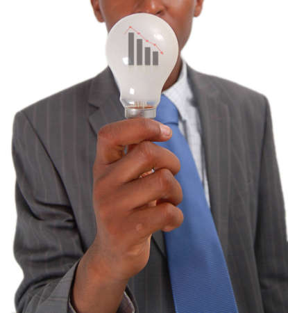 This is an image of a businessman who has an idea which will produce negative results.This represented by the falling graph within the light bulb. Image can be used for Falling Idea or Failing Ideathemes.