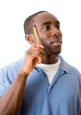 This is an image of a student trying to think of a solution. Stock Photo