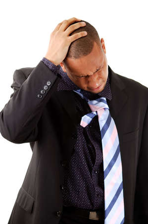 ordeal: This is an image of a businessman with his hands to his head.
