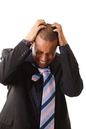 This is an image of a businessman with his hands to his head.